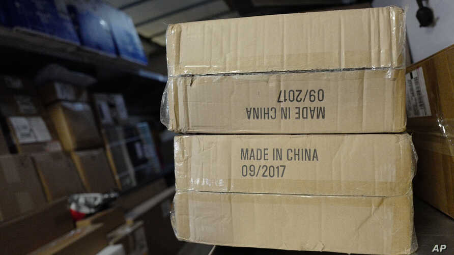 """FILE - Packages labeled """"Made in China"""" are loaded on a UPS truck for delivery in New York."""