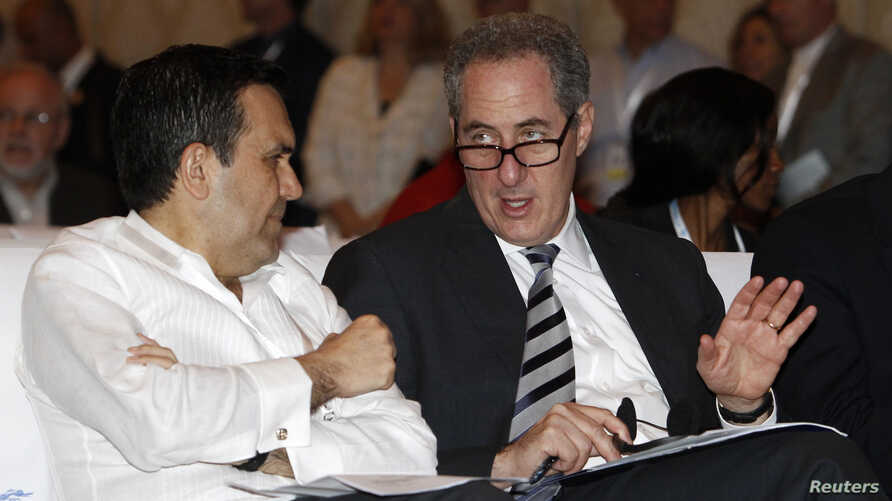 U.S. Trade Representative Michael Froman (R) attends a plenary session of the ninth World Trade Organization (WTO) Ministerial Conference in Nusa Dua, on the Indonesian resort island of Bali, Dec. 4, 2013.