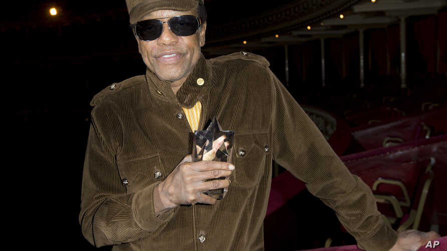 U.S singer/songwriter Bobby Womack poses for photographs after he is presented with the 'Bluesfest Lifetime Achievement Award' for Services To Soul', at the Royal Albert Hall in west London, Monday, Oct. 28, 2013