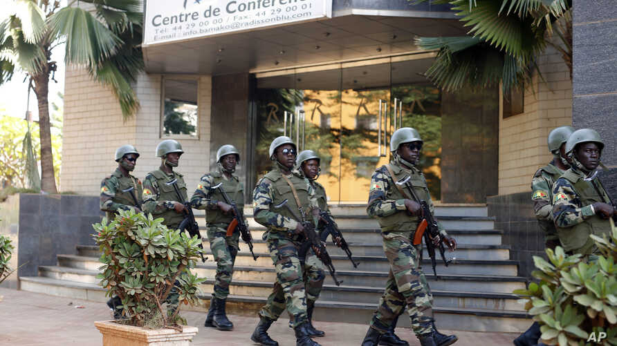 Soldiers from the presidential guard patrol outside the Radisson Blu hotel in Bamako, Mali, in anticipation of the president's visit, Nov. 21, 2015. Islamic extremists armed with guns and grenades stormed the luxury Radisson Blu hotel in Mali's capit...