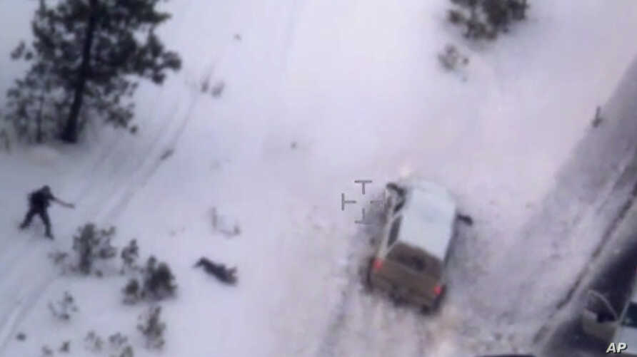 """This photo taken from an FBI video shows Robert """"LaVoy"""" Finicum, the figure in the center of the photo, after he was fatally shot by police near Burns, Ore., Jan. 26, 2016."""