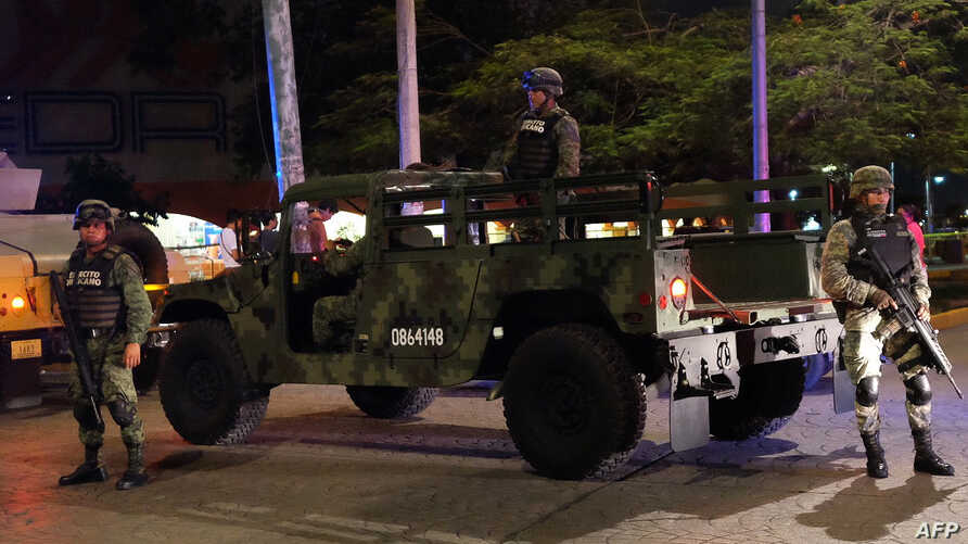 Mexican Army soldiers secure a local area after an armed confrontation between the Ministerial Police and criminal groups in the downtown area of Cancun, Quintana Roo State, Mexico. June 15, 2017.