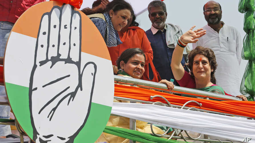 Congress party General Secretary and eastern Uttar Pradesh state in-charge Priyanka Gandhi Vadra, right, waves to party workers as she undertakes a steamer ride in the River Ganges from Manaiya, 25 kilometers (15.6 miles) from Prayagraj, India,  Marc