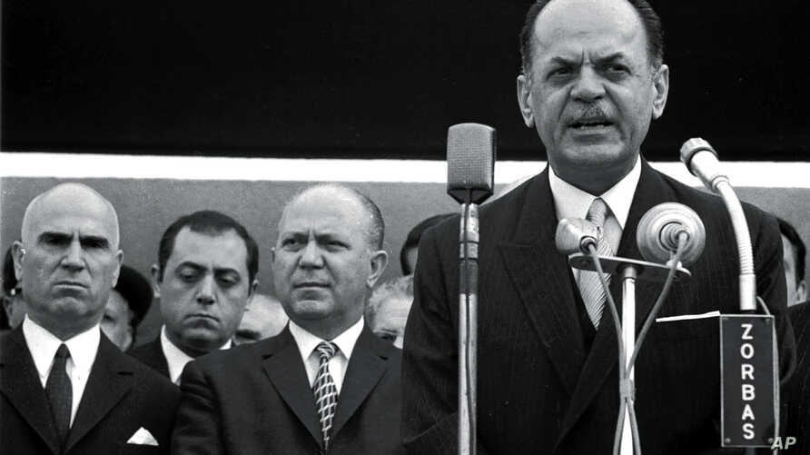 FILE -  In this 1967 file photo, Greek dictator George Papadopoulos, right, Stylianos Pattakos, far left, and Nikolaos Makarezos, center, are seen in Athens.