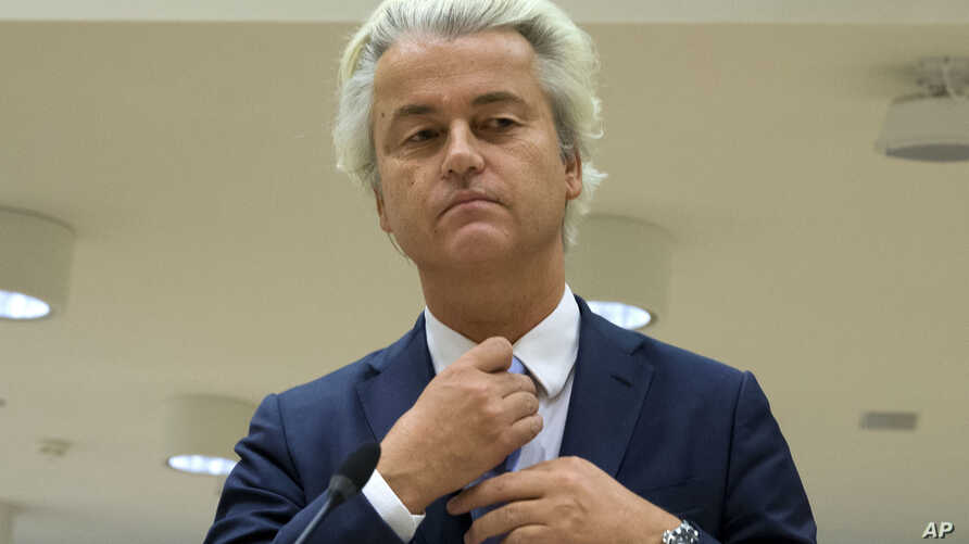 FILE - Populist anti-Islam lawmaker Geert Wilders prepares to address judges at the high-security court near Schiphol Airport, Amsterdam.