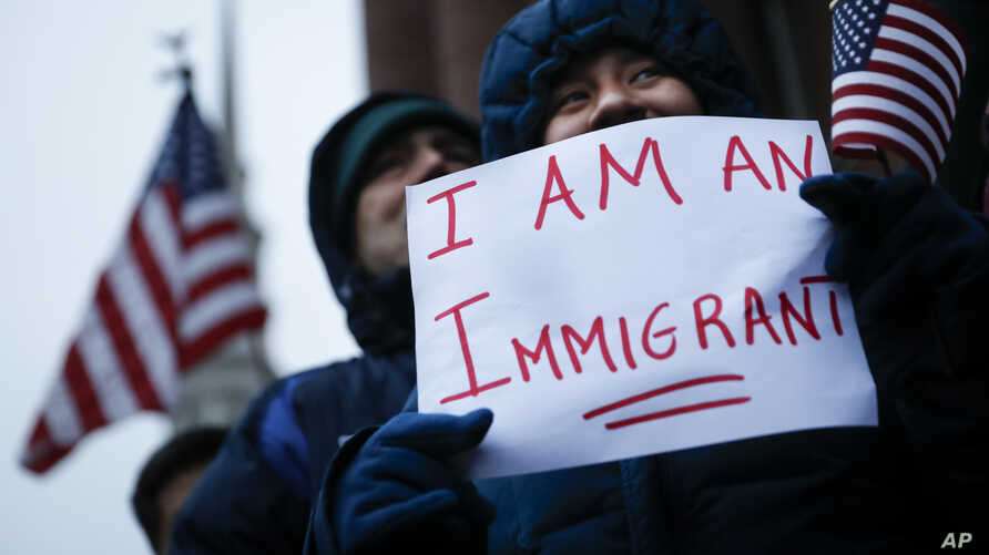 Demonstrators gather in solidarity against President Donald Trump's executive order temporarily banning immigrants from seven Muslim-majority countries from entering the U.S. and suspending the nation's refugee program Jan. 30, 2017, outside City Hal