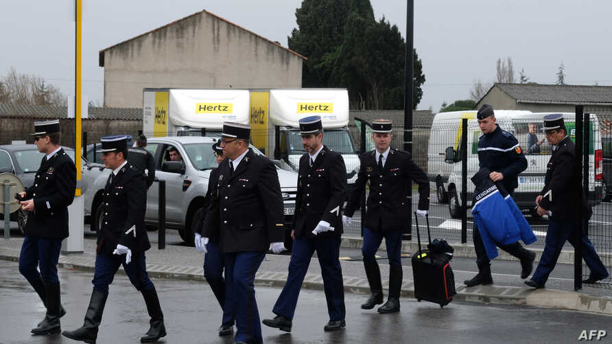 French gendarmes arrive for a ceremony for their slain colleague Lieutenant-Colonel Arnaud Beltrame at the airport in Carcassonne on March 27, 2018, from where his body is scheduled to be transported to a national ceremony to be held in Paris on Marc