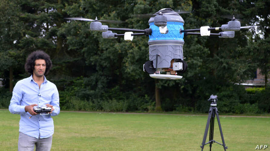 A picture taken July 4, 2016, shows Afghan refugee Massoud Hassani flying an anti-land-mine drone, called the Mine Kafon Drone, in Eindhoven, the Netherlands.