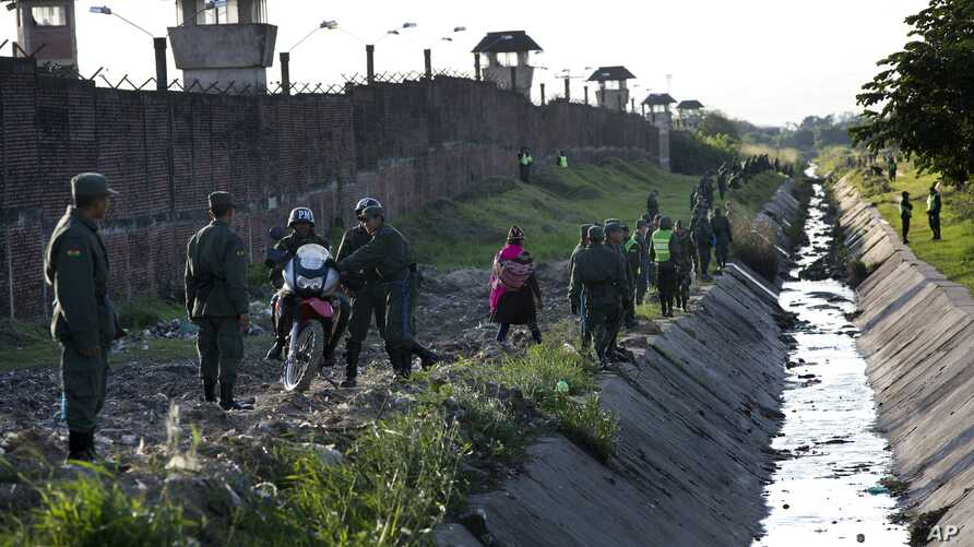 FILE - Soldiers and policemen secure the perimeter of Palmasola prison, in Santa Cruz, Bolivia, July 10, 2015.