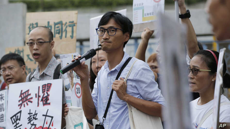 Land reform campaigner Eddie Chu, center, speaks as he thanks his supporters for their vote in the legislative elections in Hong Kong, Sept. 10, 2016.