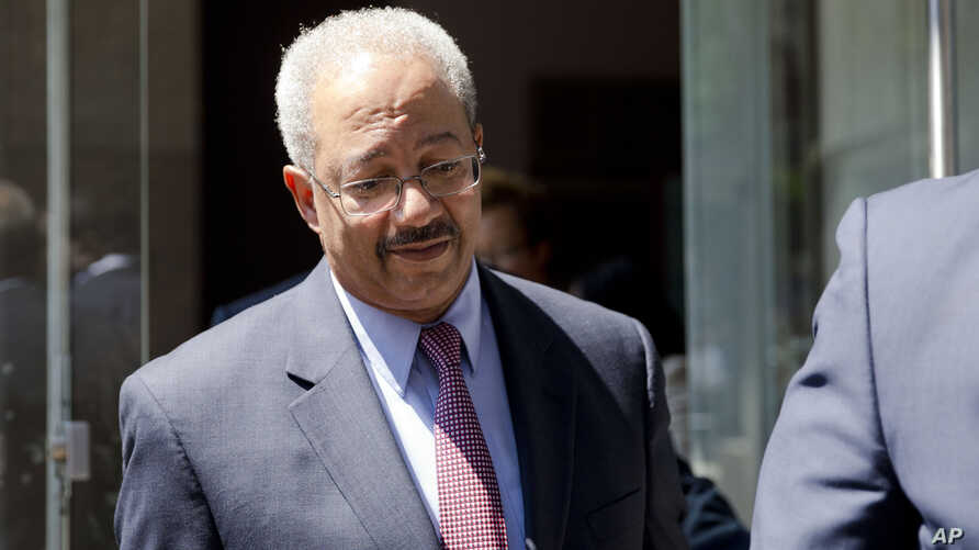 FILE - Rep. Chaka Fattah, D-Pa., exits the federal courthouse Tuesday, Aug. 18, 2015, in Philadelphia. Fattah has been indicted on charges he misappropriated hundreds of thousands of dollars of federal, charitable and campaign funds.