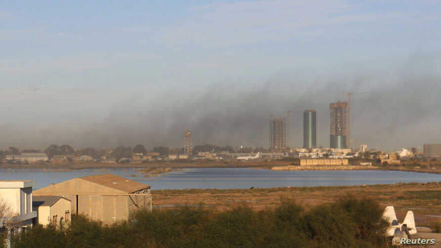 Smoke rises after an airstrike hit Maitiga airport in Tripoli, Libya, March 5, 2015.