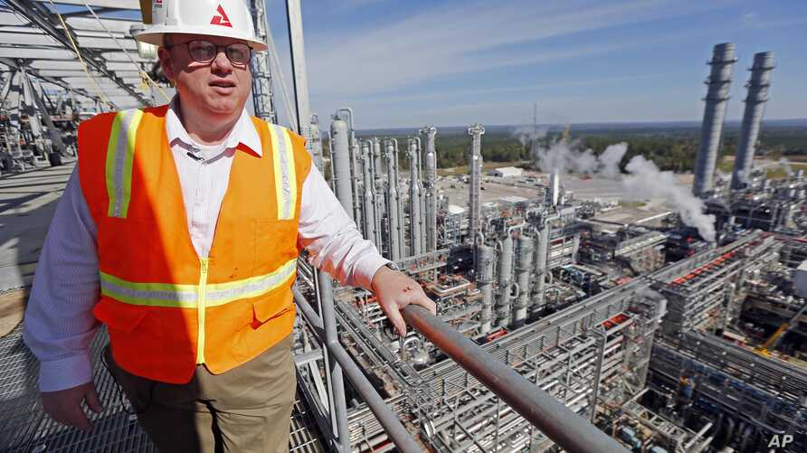 Mississippi Power spokesman Lee Youngblood talks about a carbon capture power plant from the top floor of its gasifier unit, some 66 meters above the pine forests and pastures of DeKalb, Miss., Nov. 16, 2015.