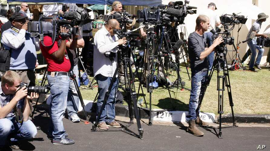 (File) Journalists report from outside the former South African President Nelson Mandela's house,  in Johannesburg, South Africa Monday, Sept. 2, 2013.
