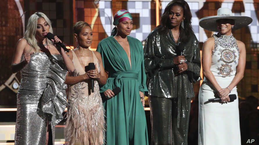 FILE - Lady Gaga, from left, Jada Pinkett Smith, Alicia Keys, Michelle Obama and Jennifer Lopez speak at the 61st annual Grammy Awards in Los Angeles, Feb. 10, 2019.