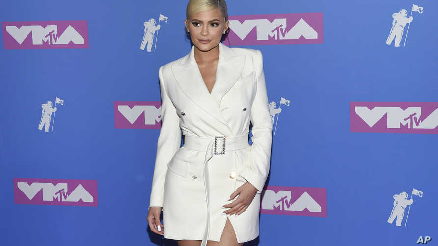 FILE - Kylie Jenner arrives at the MTV Video Music Awards at Radio City Music Hall in New York, Aug. 20, 2018.