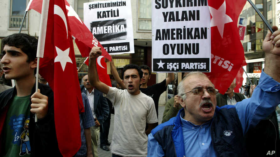 FILE - Members of the left-wing Workers' Party wave Turkish flags during a protest against the U.S. and its passing of a bill describing World War I-era killings of Armenians as genocide, in Istanbul, Turkey, Oct. 11, 2007.