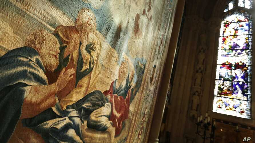 Recently preserved tapestries are displayed in an exhibit at the Cathedral of St. John the Divine in New York, March 22, 2017.