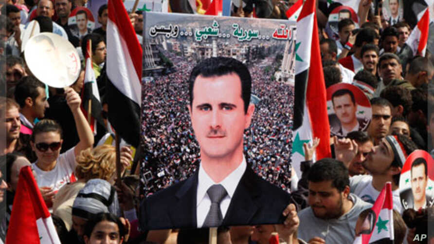 Supporters of Syrian President Bashar al-Assad rally at al-Uomawien square, Damascus, Oct. 26, 2011.