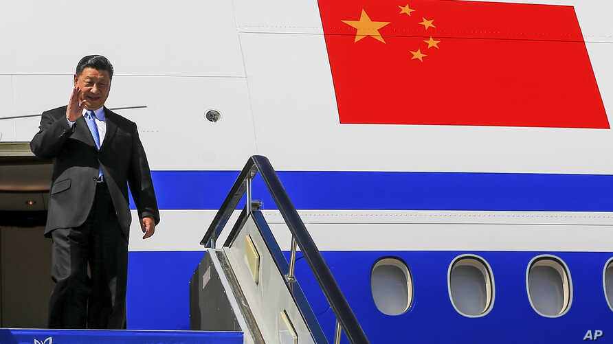 Chinese President Xi Jinping gestures as he arrived at Vladivostok, Russia, to attend the Eastern Economic Forum, Tuesday, Sept. 11, 2018.