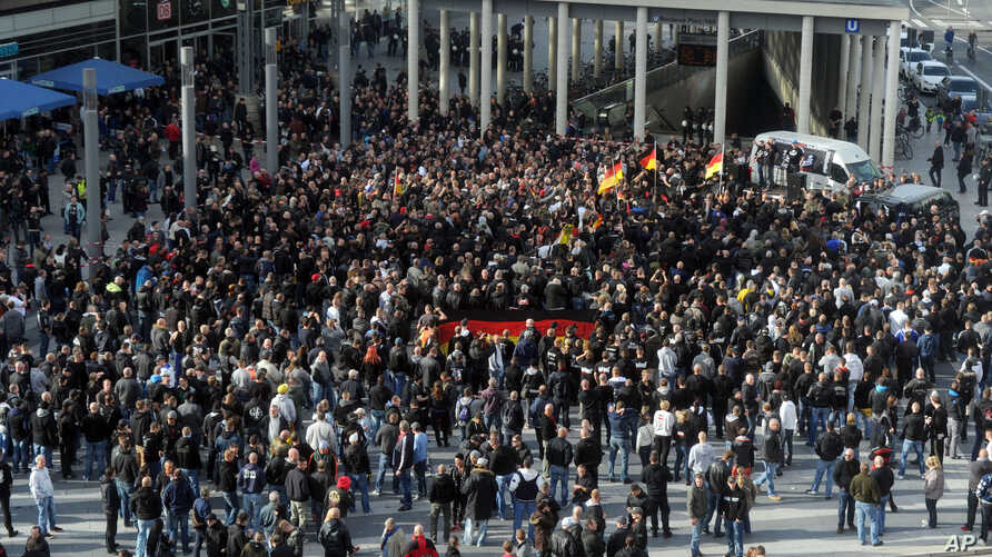 Far-right demonstrators gather in Cologne, Germany, Oct. 26, 2014.