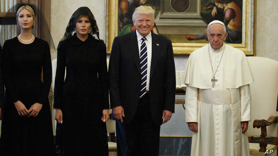 Ivanka Trump, first lady Melania Trump, and President Donald Trump stand with Pope Francis during a meeting, May 24, 2017, at the Vatican.