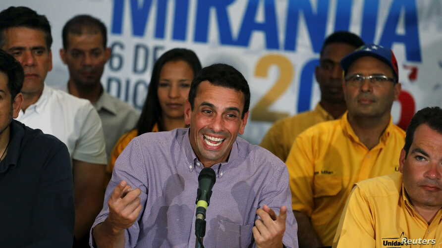 Venezuelan opposition leader Henrique Capriles speaks to journalists during a news conference in Caracas, Venezuela, Dec. 7, 2015.
