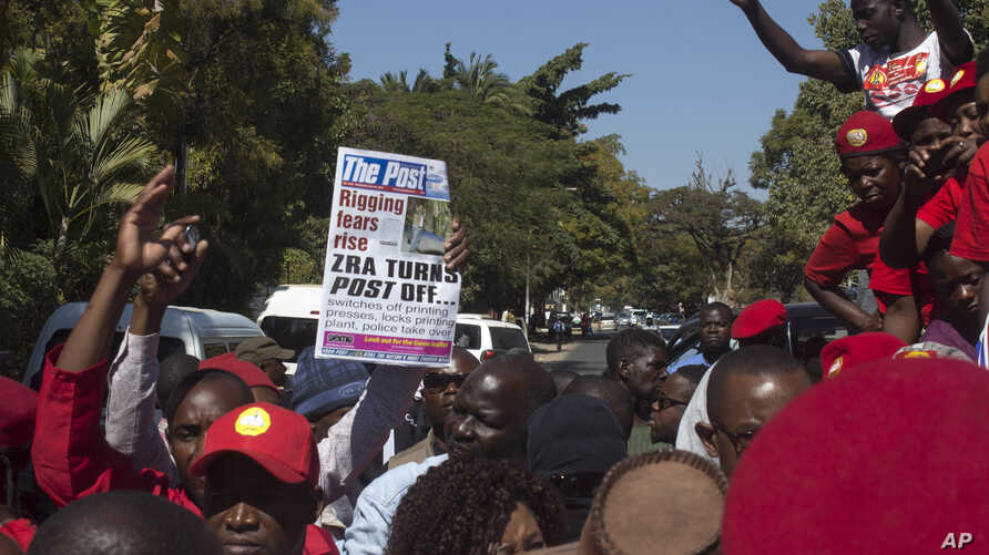 People protest the closure of The Post newspaper in Lusaka, Zambia, June 22, 2016. Zambia's government has closed the country's largest independently owned newspaper over unpaid taxes, but the paper's owner says the move is meant to shut him up befor