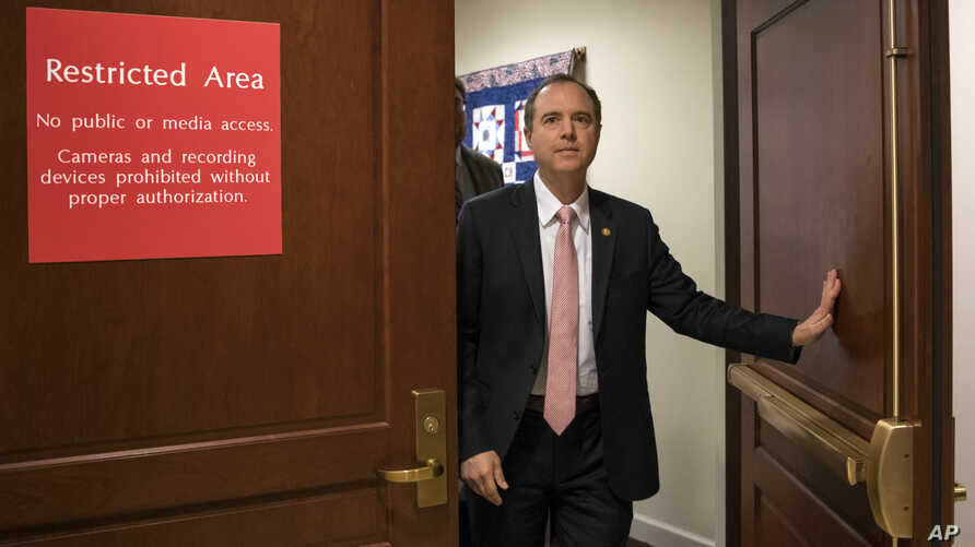 FILE - Rep. Adam Schiff, D-Calif., ranking member of the House Intelligence Committee, exits a secure area to speak to reporters, on Capitol Hill in Washington, March 22, 2018.