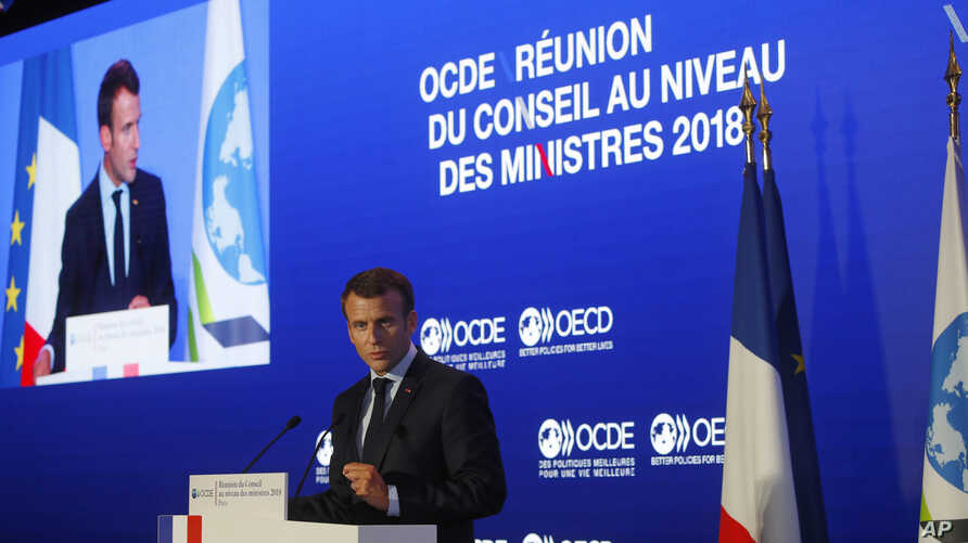 "French President Emmanuel Macron delivers a speech at the OECD ministerial council meeting on ""Refounding Multilateralism"" in Paris, May 30, 2018. Macron warned against trade wars in an impassioned speech about international cooperation Wednesday, tw"