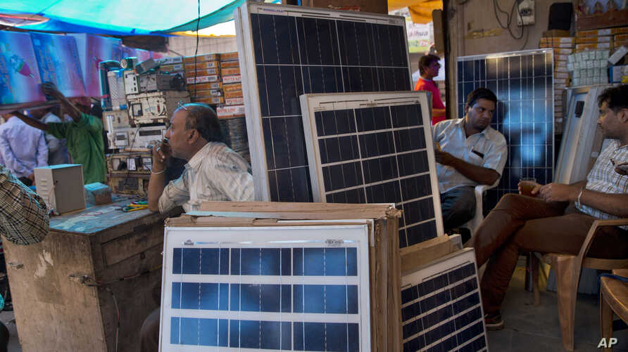 Solar panels are displayed for sale at a market in New Delhi, India. India plans a fivefold boost in renewable energy capacity in the next five years to 175 gigawatts, including solar power, wind, biomass and small hydropower dams, October 1, 2015.
