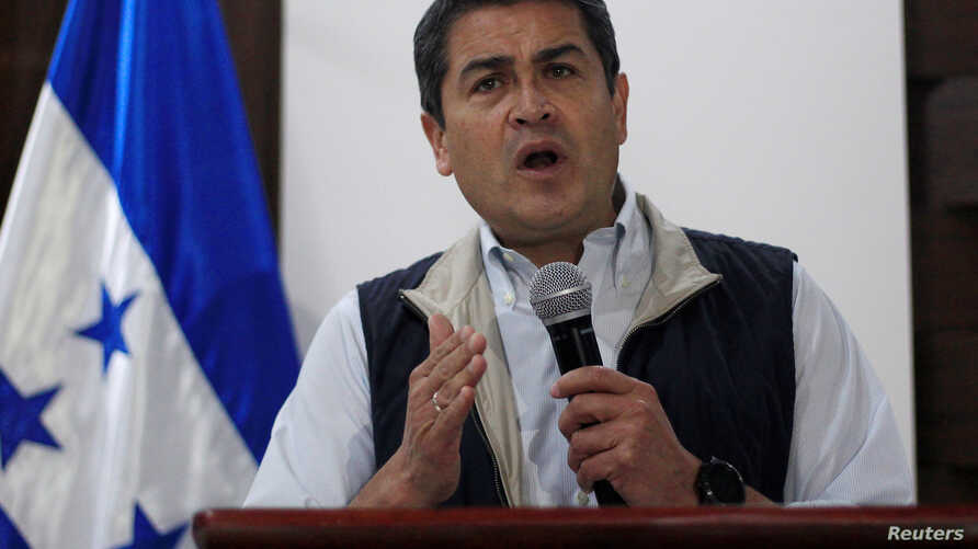 Honduras President and National Party candidate Juan Orlando Hernandez gestures as he addresses the media in Tegucigalpa, Honduras, Dec. 4, 2017.