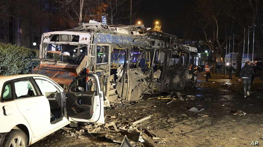 Damaged vehicles are seen at the scene of an explosion in Ankara, Turkey, Sunday, March 13, 2016.