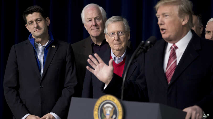 President Donald Trump, accompanied by from left, House Speaker Paul Ryan of Wis., Senate Majority Whip Sen. John Cornyn, and Senate Majority Leader Mitch McConnell, speaks to members of the media at Camp David, Jan. 6, 2018.