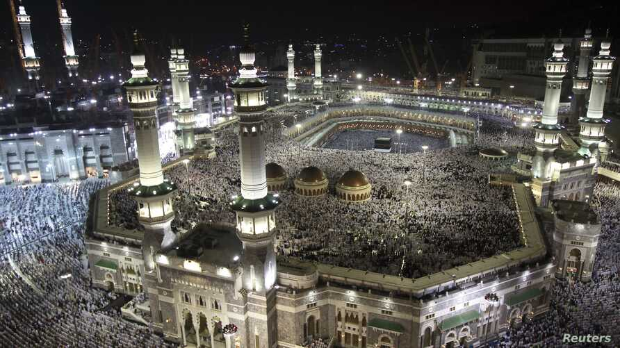 Muslim pilgrims circle the Kaaba and pray at the Grand mosque during the annual haj pilgrimage in the holy city of Mecca, October 22, 2012.