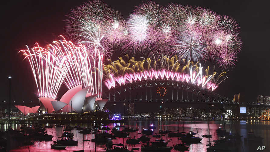 Fireworks explode over the Opera House and the Harbour Bridge during New Years Eve  celebrations in Sydney, Australia, Thursday, Jan. 1, 2015.