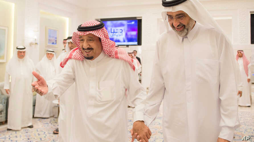 In this Aug. 17, 2017 image released by the state-run Saudi Press Agency, Saudi King Salman, left, meets Qatari Sheikh Abdullah Al Thani, right, at the monarch's vacation home in Tangiers, Morocco. A planned conference in London by a self-described Q