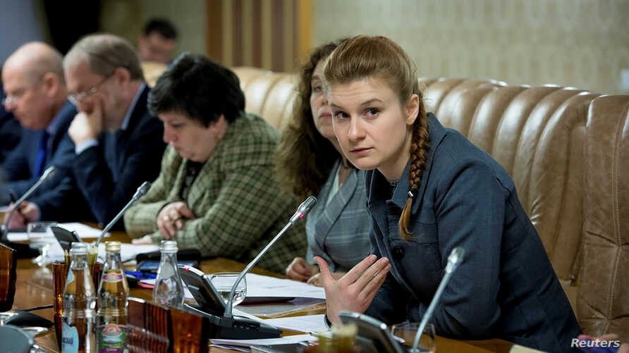 Public figure Maria Butina (R) attends a meeting of a group of experts, affiliated to the government of Russia, in this undated handout photo obtained by Reuters on July 17, 2018.