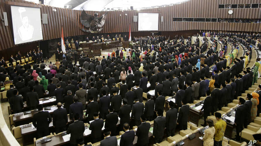 FILE - New members of Indonesia's parliament gather to be sworn in during their inauguration at the parliament building in Jakarta, Indonesia, Oct. 1, 2014.