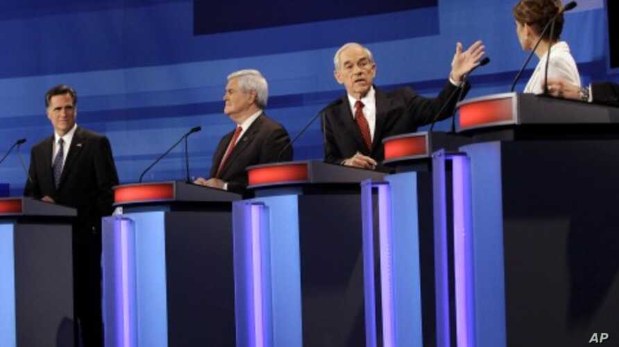 Republican presidential candidates from left, former Massachusetts Gov. Mitt Romney, former House Speaker Newt Gingrich, Rep. Ron Paul, R-Texas, and Rep. Michele Bachmann, R-Minn., participate in a Republican presidential debate in Sioux City, Iowa,