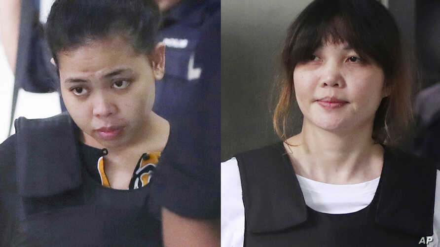 Indonesian Siti Aisyah, left, and Vietnamese Doan Thi Huong, right, are escorted by police as they leave their court hearing at Shah Alam court house in Shah Alam, outside Kuala Lumpur, Malaysia, Oct. 2, 2017.