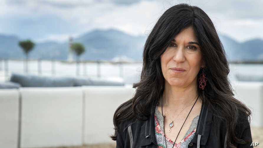 "FILE - Director Debra Granik poses for portrait photographs for the film ""Leave No Trace,"" at the 71st international film festival, Cannes, southern France, May 14, 2018."