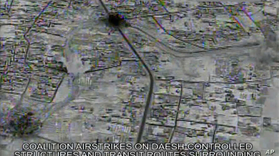 This image made from gun-camera video taken on July 4, 2015 and released by United States Central Command shows an airstrike on a main road and transit route near the Islamic State group-held Raqqa, Syria.