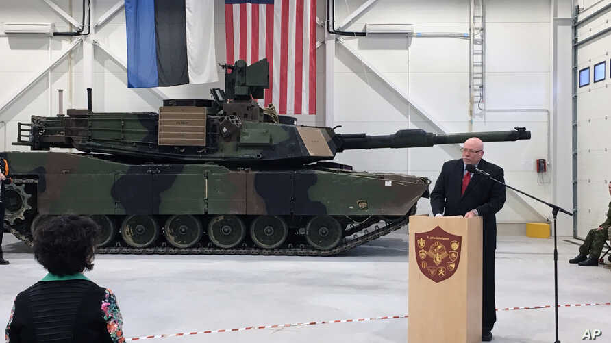 [÷/ُ - U.S. Ambassador to Estonia James D. Melville Jr. addresses dignitaries in front of an U.S. Army tank, at a hand-over ceremony of the upgraded NATO military base in Tapa, Estonia, Thursday, Dec. 15, 2016.