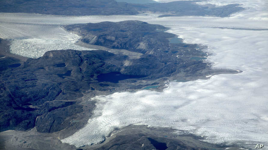 FILE - The Greenland ice sheet is seen in southeastern Greenland, Aug. 3, 2017.