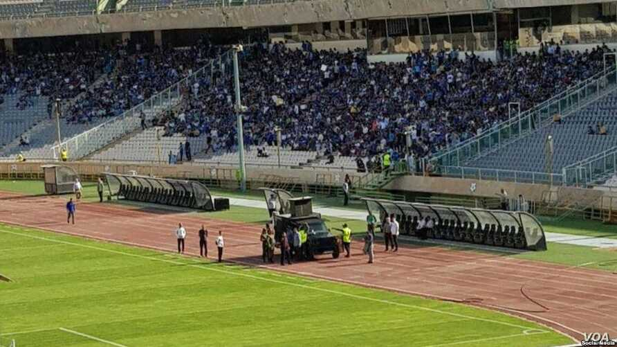 "In this photo shared on social media, an Iranian military vehicle is deployed at Tehran's Azadi Stadium on August 10, 2018 in an apparent effort to quiet football fans chanting ""death to the dictator"" ahead of a match."