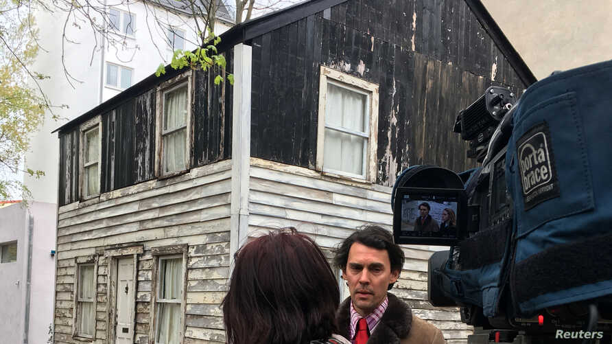 Artist Ryan Mendoza gives an interview in front of Rosa Parks' house in Berlin, Germany, April 11, 2017.