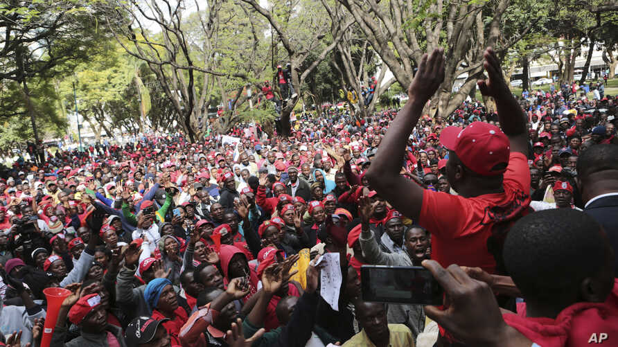 Opposition supporters march on the streets of Harare, Zimbabwe, Tuesday, June, 5, 2018. The party supporters were demanding electoral reforms ahead of a July 30 vote, the first since Robert Mugabe stepped down last year.
