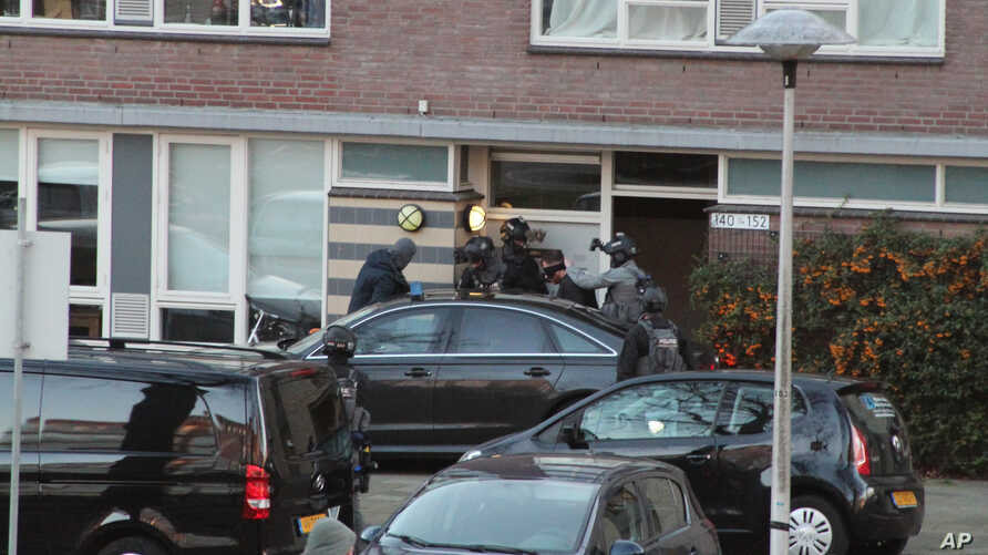 FILE - 37-year-old Gokmen Tanis is led away by police in Utrecht, Netherlands, March 18, 2019, after a shooting incident on a tram.