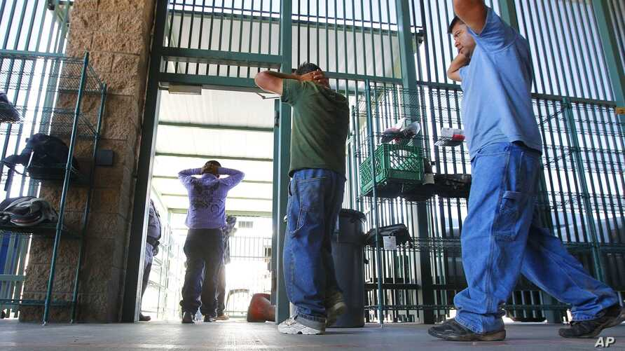 FILE - Suspected illegal immigrants are being processed at the Tucson Sector of the U.S. Customs and Border Protection headquarters in Tucson, Ariz., Aug. 9, 2012.